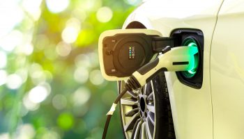 Ev,Car,Or,Electric,Car,At,Charging,Station,With,The